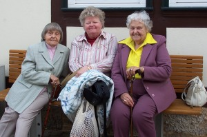 Three old ladies sitting in a row. 2006