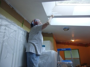Good bones equals skylights in the kitchen. White paint reflects light and you can wash it now.