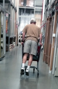 Tech support riding the cart while shopping. They never grow up really.