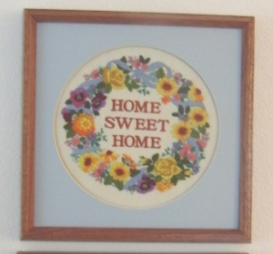 Home is where we can ground ourselves and share with others. I hand embroidered this piece.