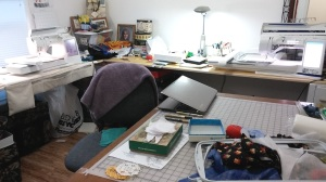 Organized chaos in the sewing room. Both machines working at the same time while I addressed cards.