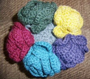 A bouquet of knit roses in wonderful colors
