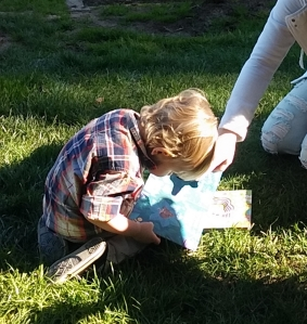 He can't see the books well but he loves them. Great grandson