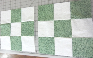 another job finished. 2 green squares to add  to more for charity quilt. Pattern in fabric adds texture