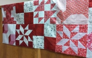 What's hanging over the other side. Can you find my blocks? This one will go to safe house when quilted by someone else.