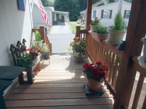 Filling front porch with flowers out of the heat