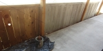 part stained fence