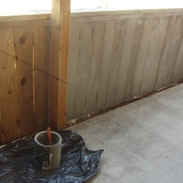 part of one side of driveway fence stained and sealed.