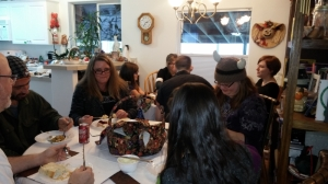 Dining and kitchen table pushed together and had an informal gathering.