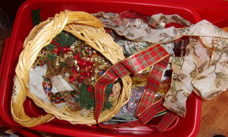 Several bins of leftover and saved ribbons and bow