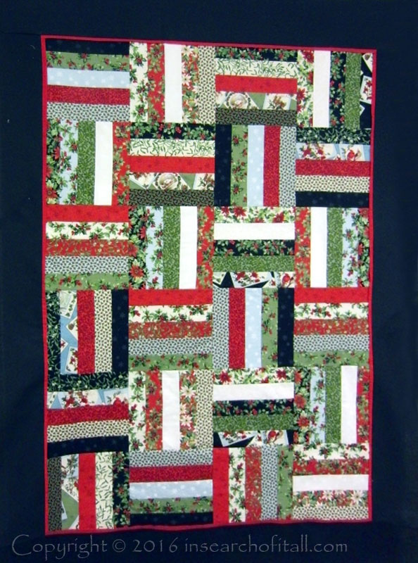 jelly roll Christmas quilt done in record time.
