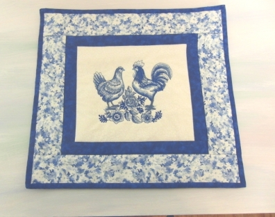 For my friends 80th birthday. She loves blue and white and chickens so I did the embroidery on my old machine.