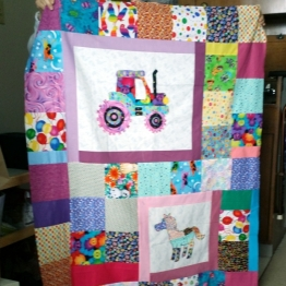 Laurie made several of these appliqued quilts for kids.