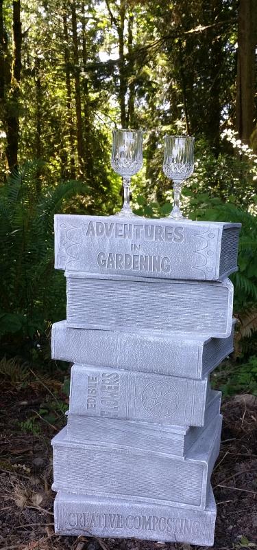Cordial glasses on resin stack of garden books