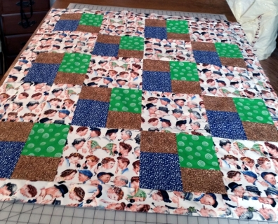 Funny faces on a not so pretty quilt